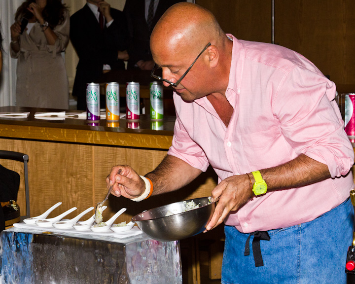 Zimmern adding chopped onions to the amuse bouche of clam.