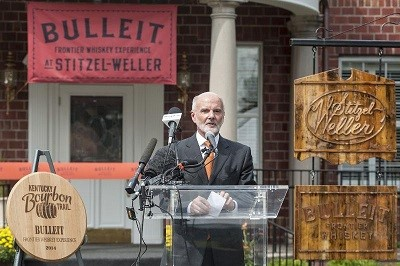Bulleit Bourbon Founder Tom Bulleit speaks at the ribbon-cutting event for the Bulleit Frontier Whiskey Experience at Stitzel-Weller