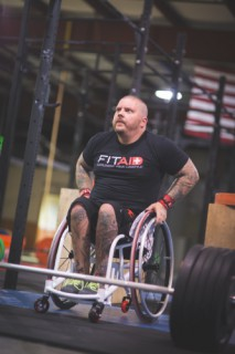 Michael Mills in the FitAID custom wheelchair (PRNewsFoto/LifeAID Beverage Company)