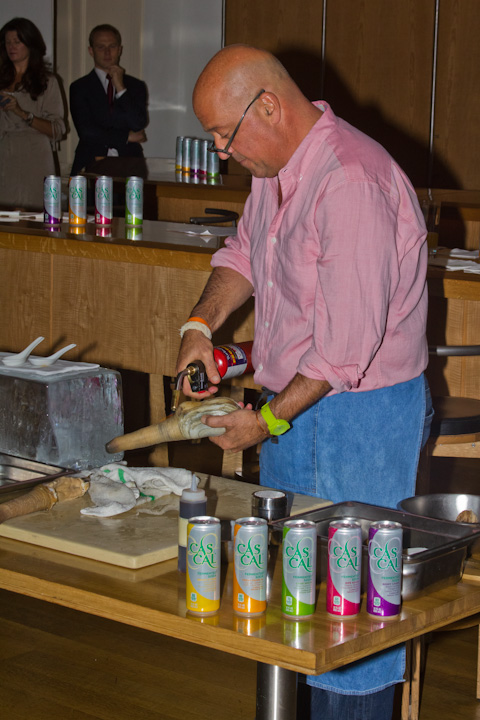 Zimmern blowtorching a geoduck clam.
